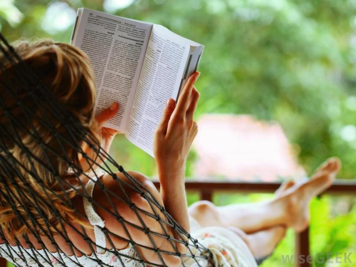 woman-reading-book-while-in-hammock